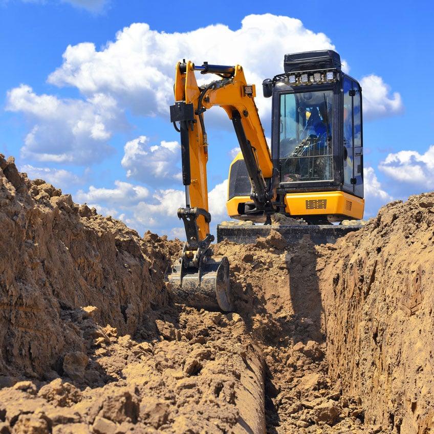 excavator-hire-rates-mini-excavator-digging-dirt