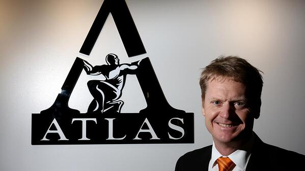 Managing Director of Atlas Iron with logo in the background
