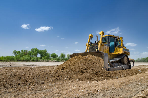 bulldozer-digging-dirt-construction-site