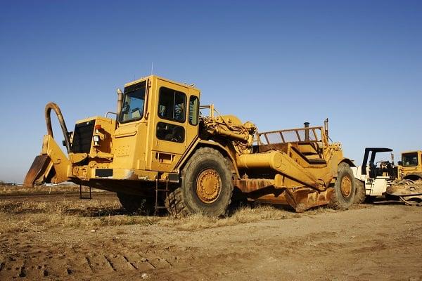 scraper-construction-site