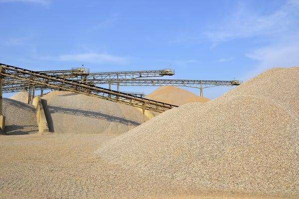 Mining fine aggregate; sand, gravel piles