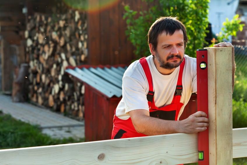 Man building a fence
