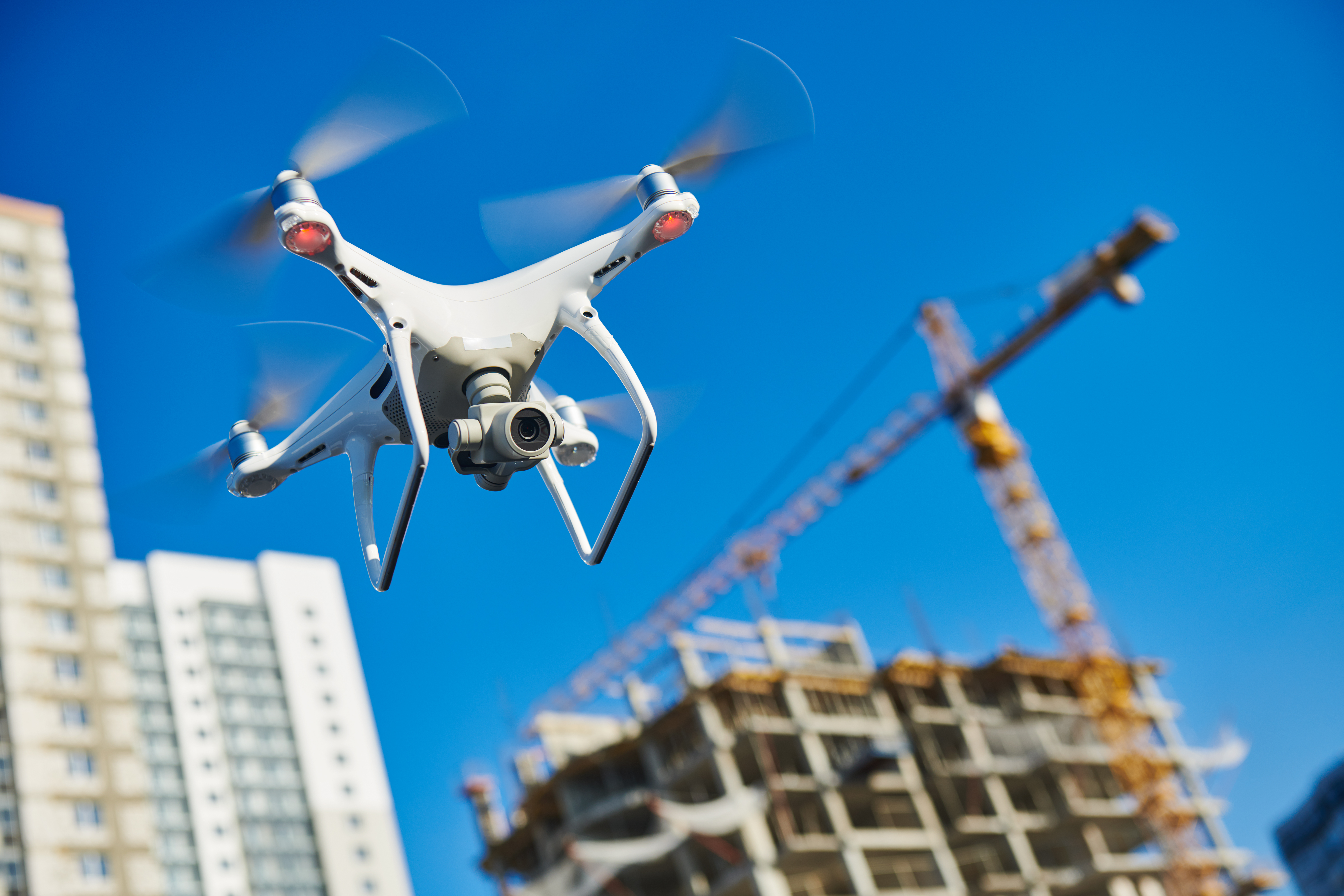 Drone flies over a construction site